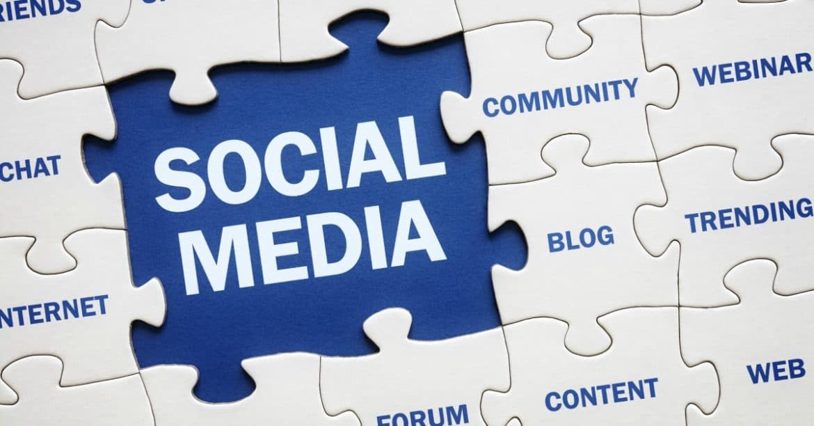 Social media and related topics pieced together in a jigsaw puzzle